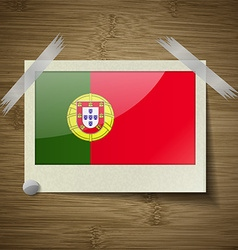Flags Portugal at frame on wooden texture vector image