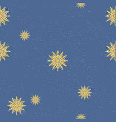 seamless chaotic pattern of golden snowflakes on vector image