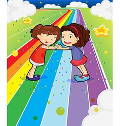 Two girls holding their hands at the colorful road vector image