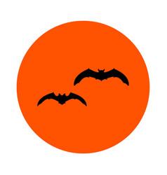 Two black bats on an orange circle round vector