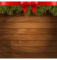 Christmas tree red bow on the wood background vector