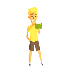 Young man in a yellow shirt standing and reading a vector