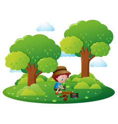 Boy planting tree in park vector