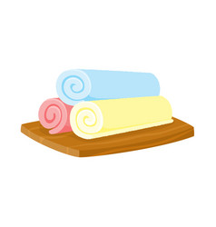 Three pieces of rolled up colorful towels on vector