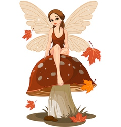 Autumn fairy on the mushroom vector