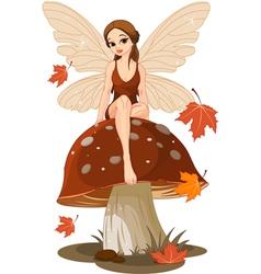 Autumn fairy on the mushroom vector