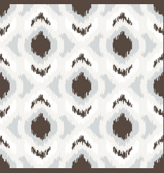 Ikat geometric seamless pattern white and brown vector