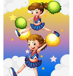 Two cheerdancers with their pompoms vector