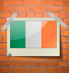 Flags ireland scotch taped to a red brick wall vector