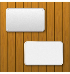 Two metal plates on a wooden wall vector image