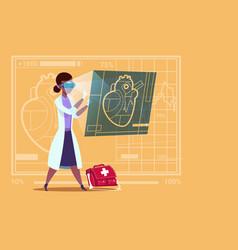 female doctor cardiologist examining digital heart vector image vector image