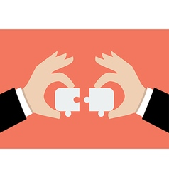 Hands pushing two jigsaw pieces together vector