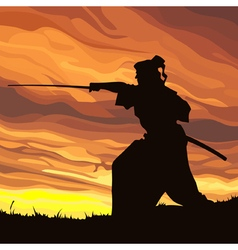 Samurai silhouette against the sunset vector