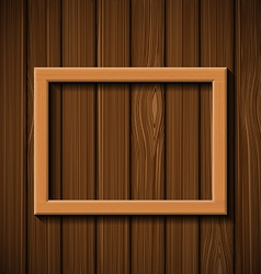 Wooden picture frame hanging on the wall vector
