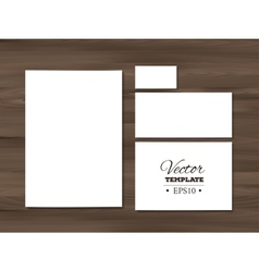 Corporate identity templates on a wooden vector