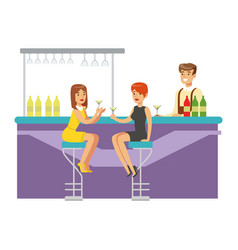 two girlfriends drinking cocktails at the bar vector image