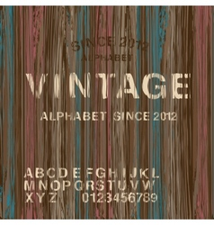 Vintage stamp alphabet and wooden background vector