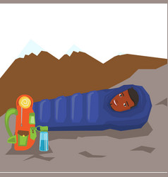 Man resting in sleeping bag in the mountains vector