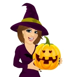 Young woman dressed like witch holding pumpkin vector image