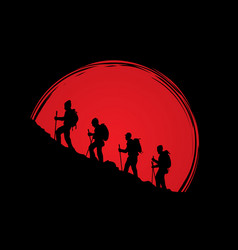 A group of people walking on mountain vector