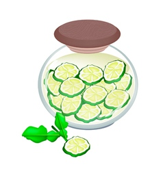 Preserved kaffir lime fruit in a jar vector