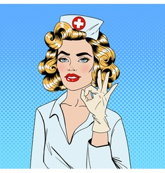 Pretty nurse in pop art style gesturing okay vector