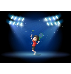 A young boy playing tennis at the stage vector