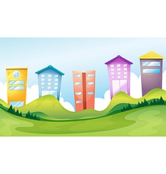 Tall buildings across the hills vector