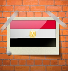 Flags egypt scotch taped to a red brick wall vector