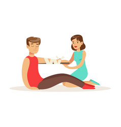 Woman bandaging the hand of the injured man first vector