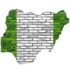 Nigeria map on a brick wall vector