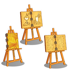 three canvases on stand with different pictures vector image vector image