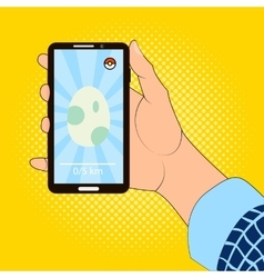 Smartphone in hand with the image of the egg game vector