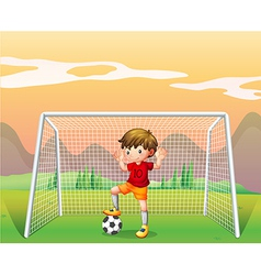 A soccer player in a red shirt vector image