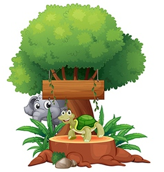 A turtle and an elephant under the big tree with a vector image vector image