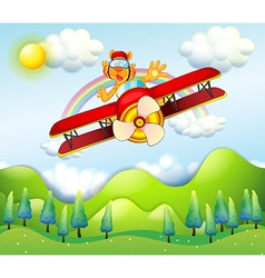 A red airplane driven by a tiger vector image