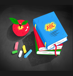 Red apple pile of books and pieces of chalk vector