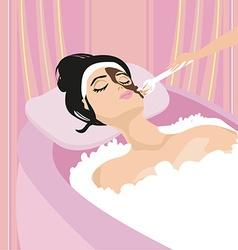 Woman having beauty treatments in the spa salon vector image