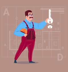 cartoon builder holding key from new house over vector image vector image