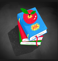 Top view of apple on pile of books vector