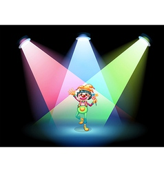 A female clown with flowers at the stage vector