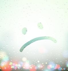 Sad face painted on sweaty window vector