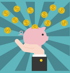 Hand holding piggy bank with coins vector