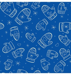Winter seamless pattern with mittens on blue vector