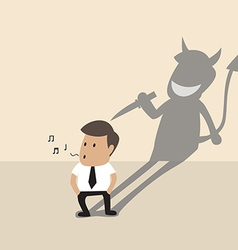 Businessman with his devil shadow vector