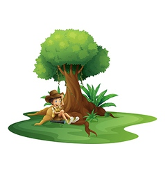 A boy resting under the tree vector image