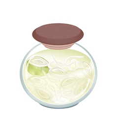A jar of pickled onion with malt vinegar vector