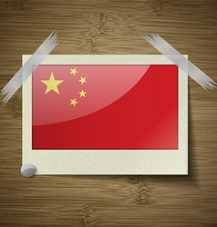 Flags china at frame on wooden texture vector