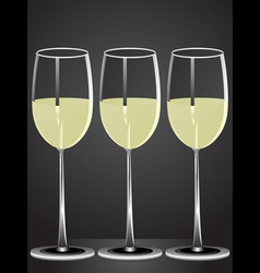Glasses of white wine on table with dark backgroun vector