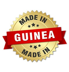 made in Guinea gold badge with red ribbon vector image vector image